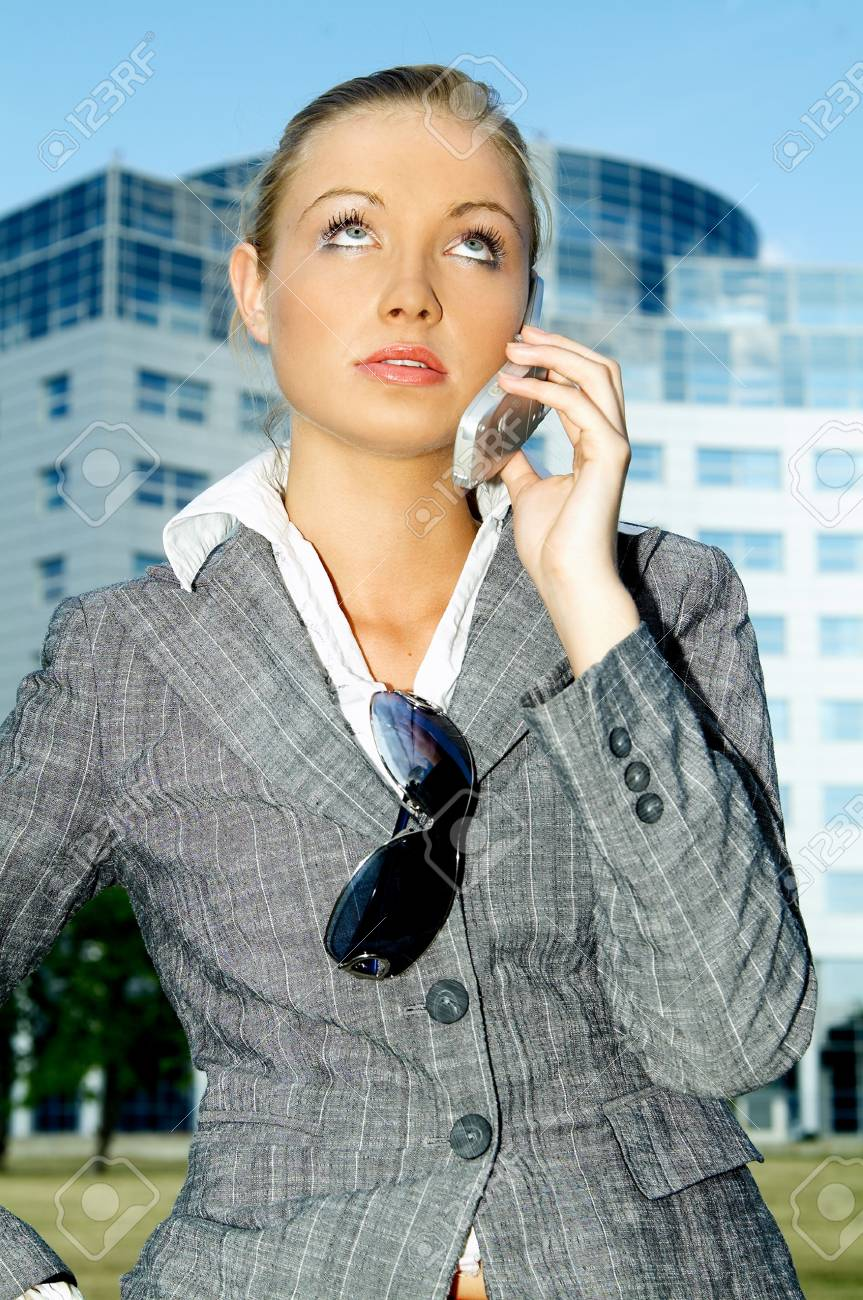 Business woman using a mobile phone Stock Photo - 453900