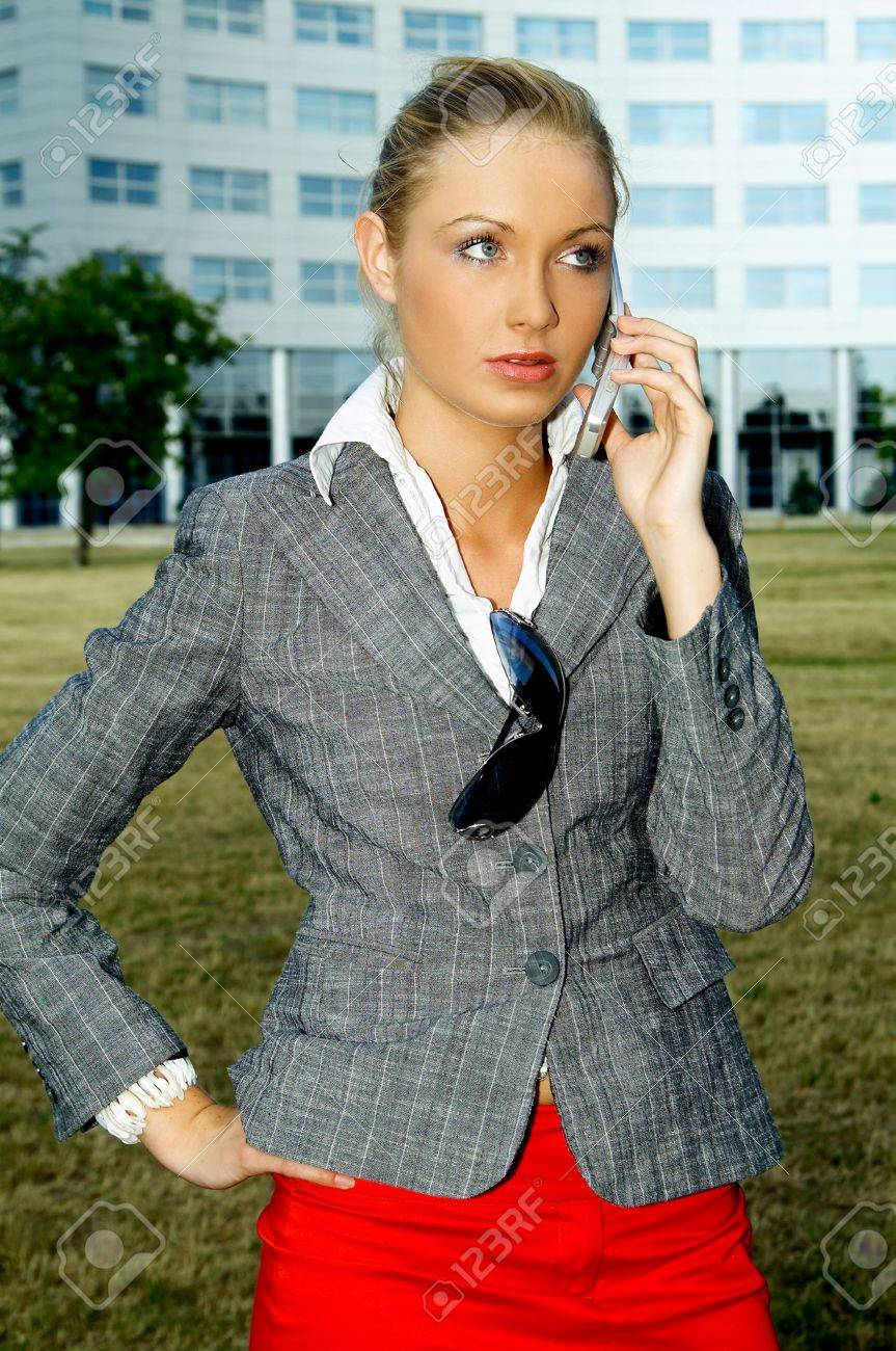 Business woman using a mobile phone Stock Photo - 453890