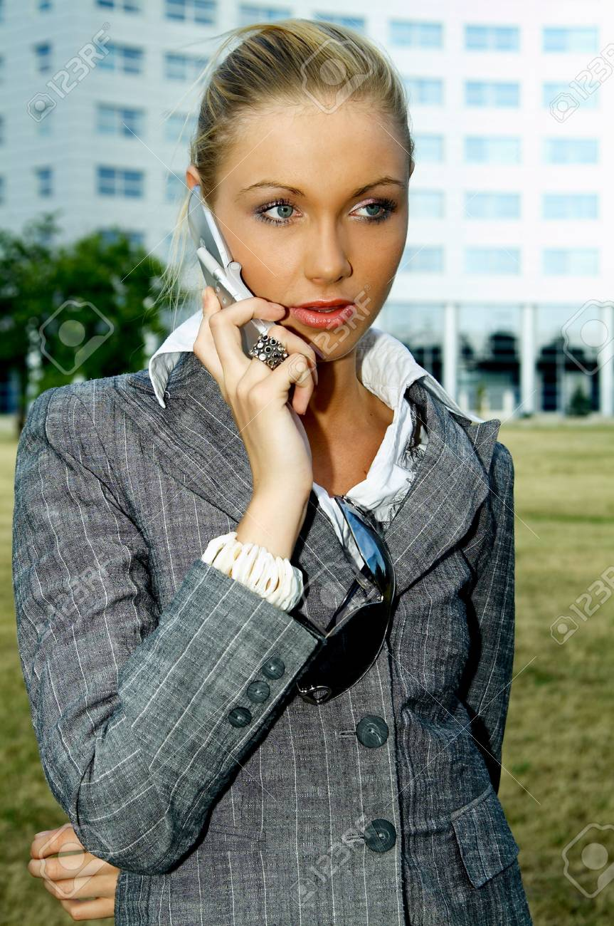 Business woman using a mobile phone Stock Photo - 453896