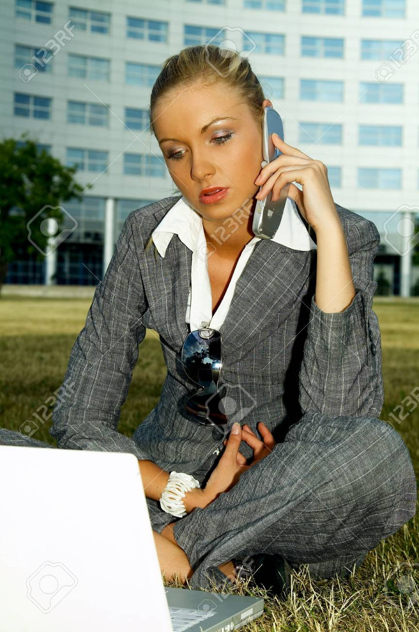 Business woman working on grass with laptop computer Stock Photo - 453897