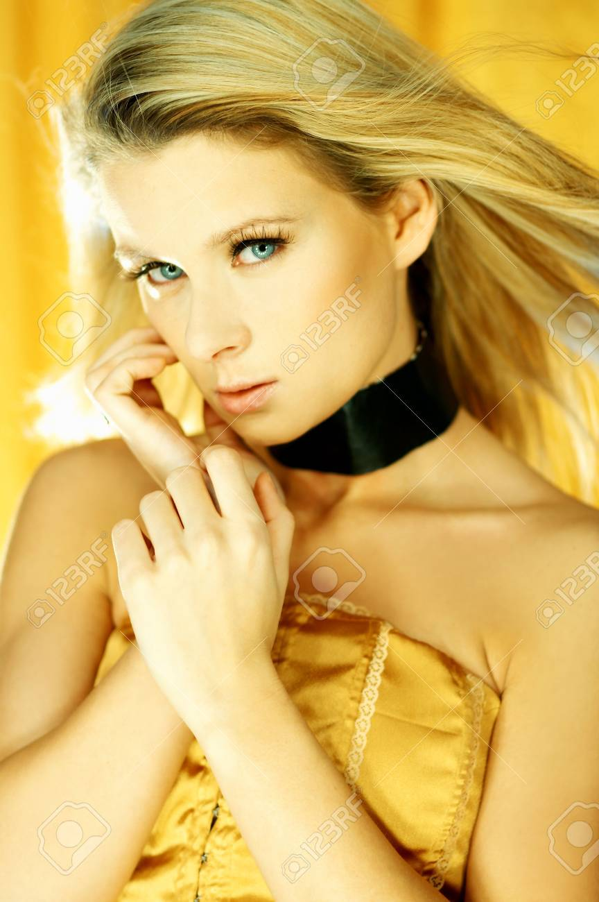 Portrait of attractive beautiful young woman posing on yellow background Stock Photo - 603529