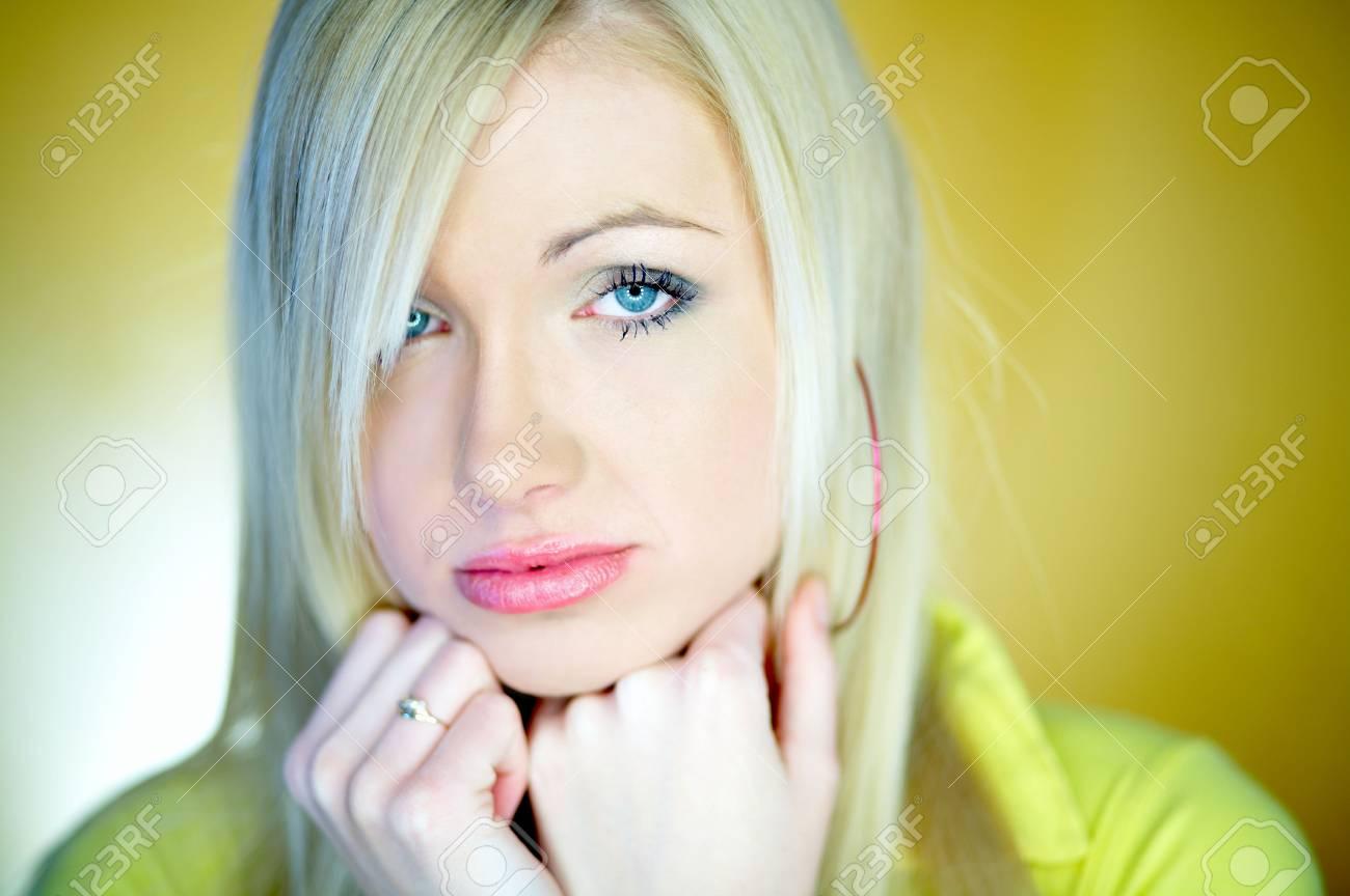 Portrait of beautiful blond woman wearing yellow shirt Stock Photo - 734143