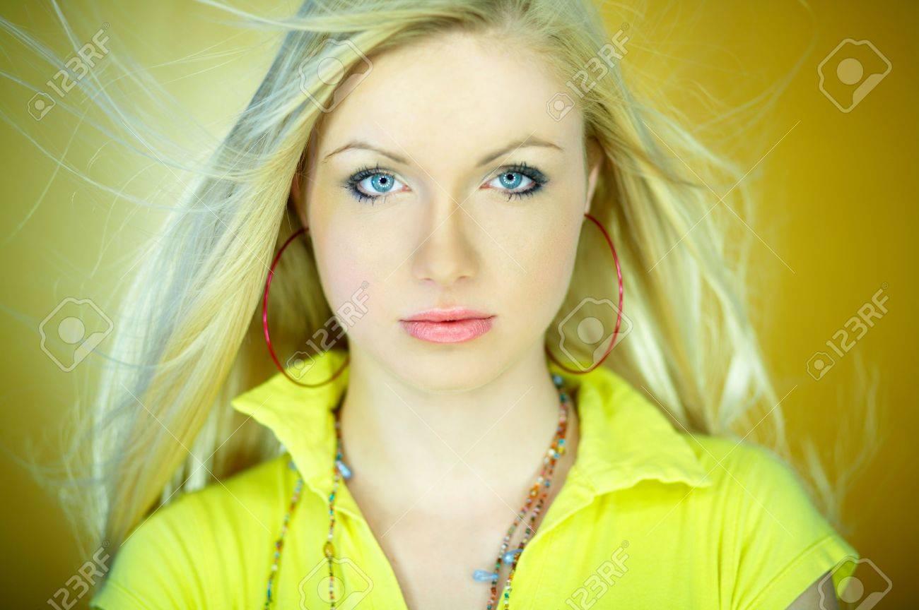 Portrait of beautiful blond woman wearing yellow shirt Stock Photo - 734096