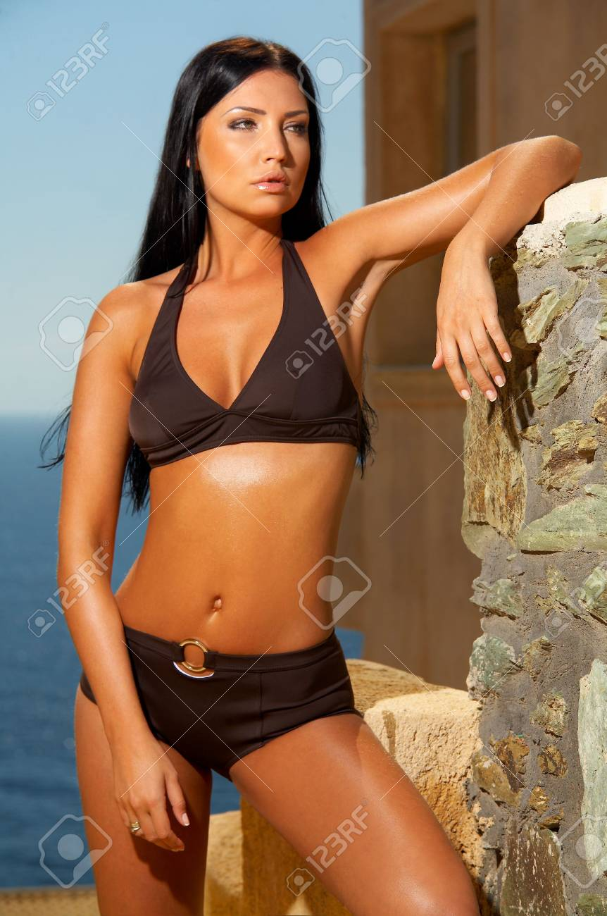 Beautiful young Sexy brunette woman posing in swimming wear Stock Photo - 962205
