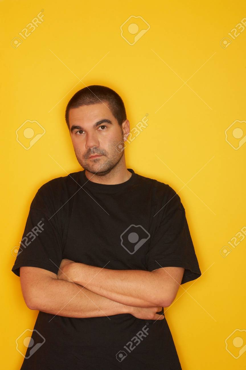 25-30 years old handsome caucasian man posing at yellow background Stock Photo - 1092558