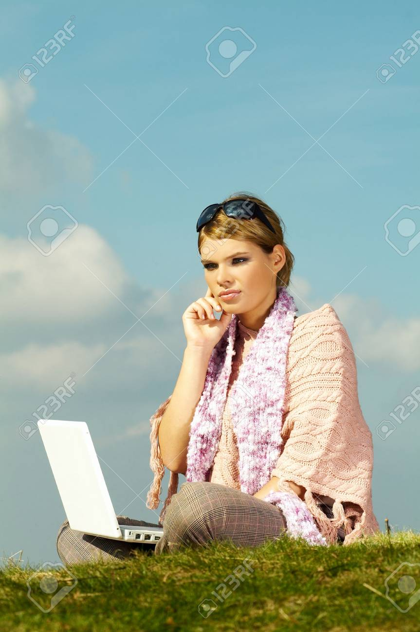 Young business woman relaxing, working on laptop computer on meadow Stock Photo - 1745021