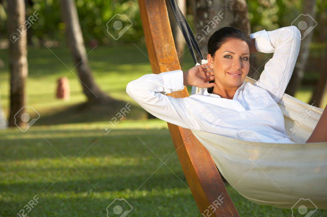 20-25 years woman portrait relaxing on hammock at exotic surrounding, bali indonesia Stock Photo - 1978526