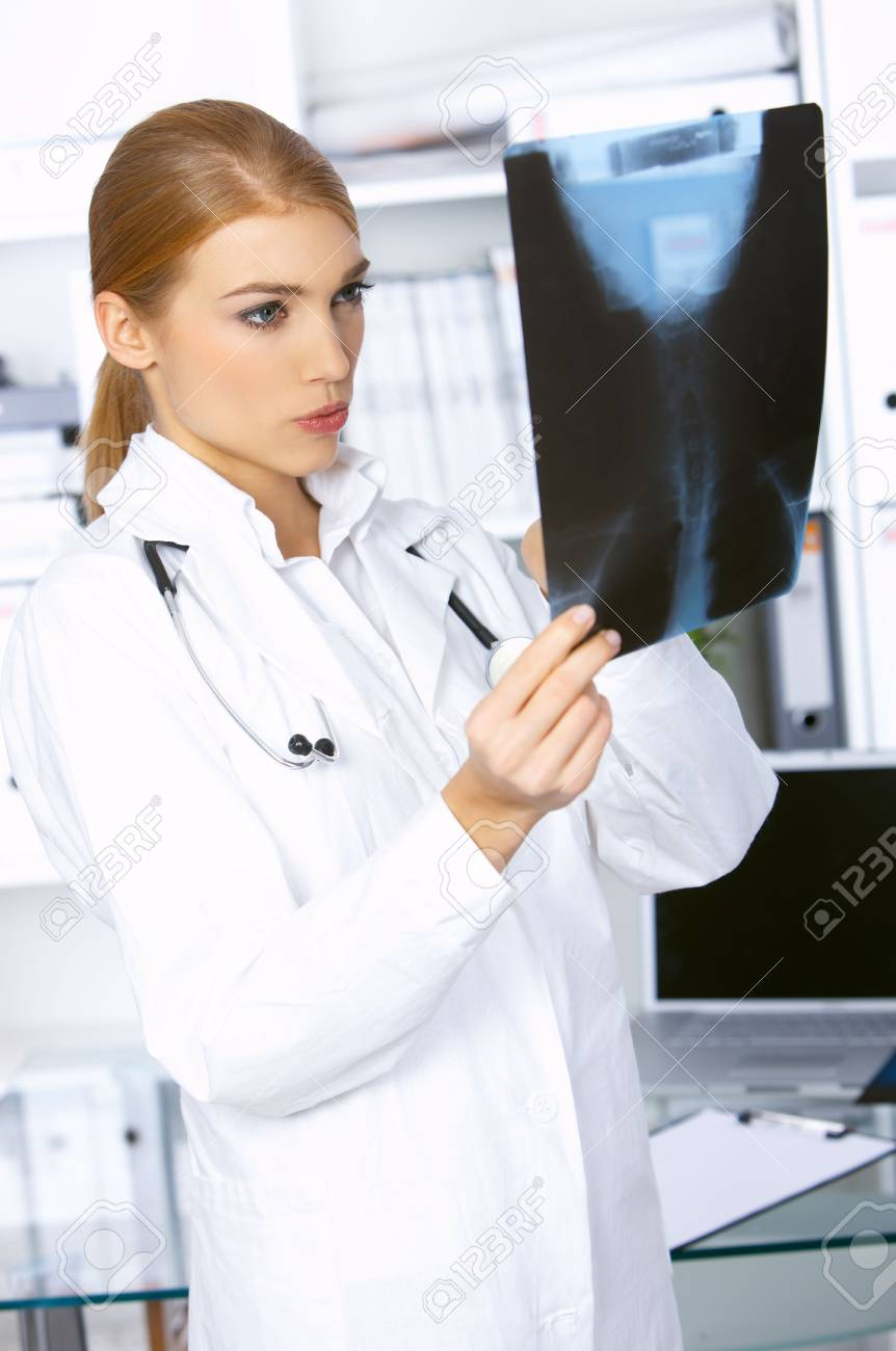 Female doctor examining x-ray picture and is worried Stock Photo - 3963047