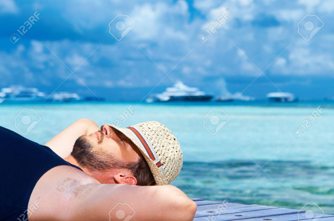 Handsome man resting near water at Maldives Stock Photo - 6878933