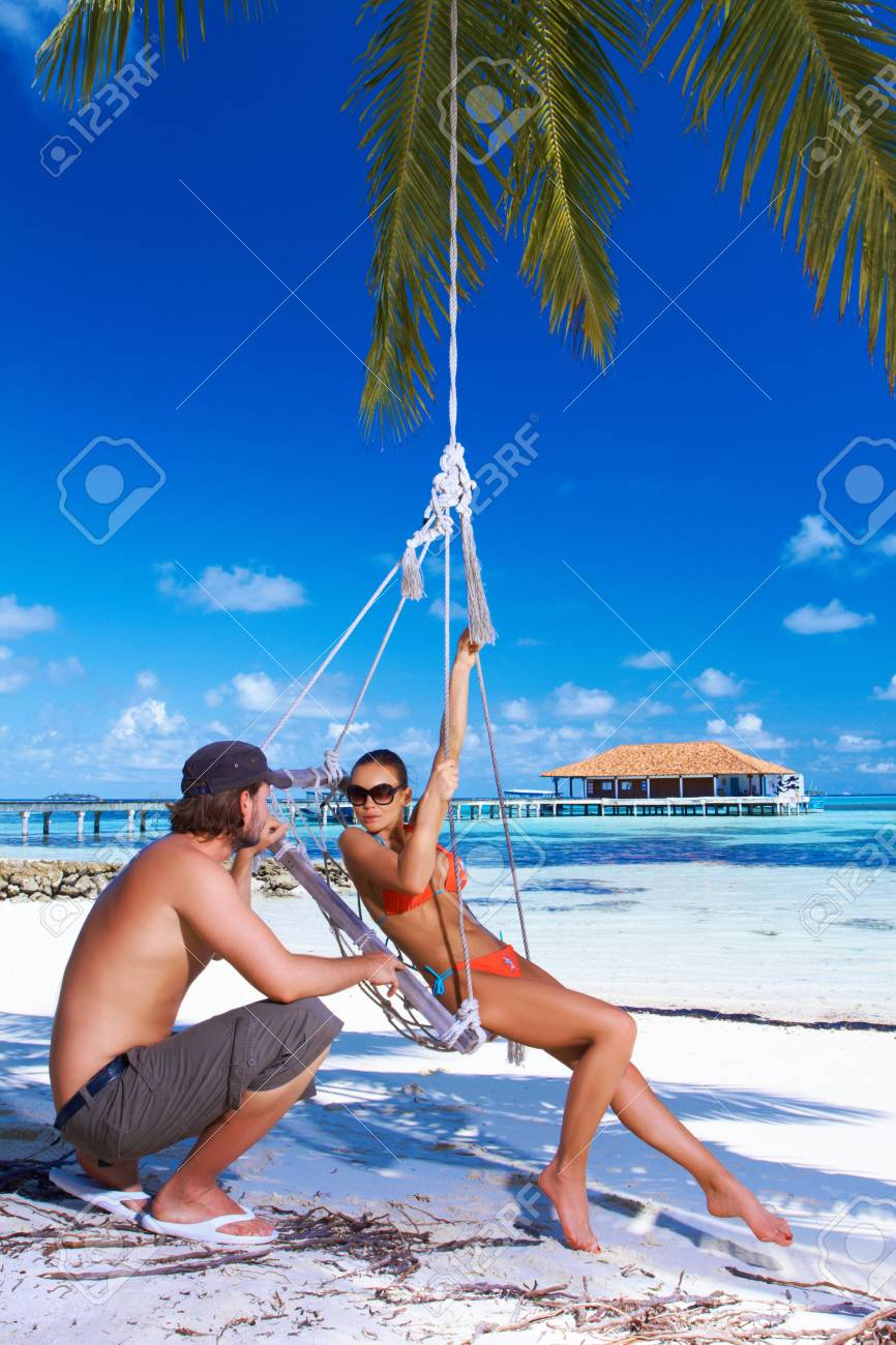 Romantic couple resting at Maldives seaside Stock Photo - 6878973