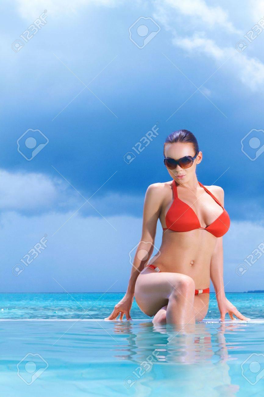 Beautiful woman resting near pool at Maldives Stock Photo - 6878968