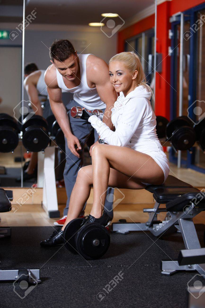 Sporty couple exercising at the gym Stock Photo - 7316059
