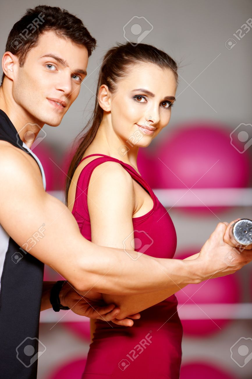 Sporty couple exercising at the fitness gym Stock Photo - 9796014