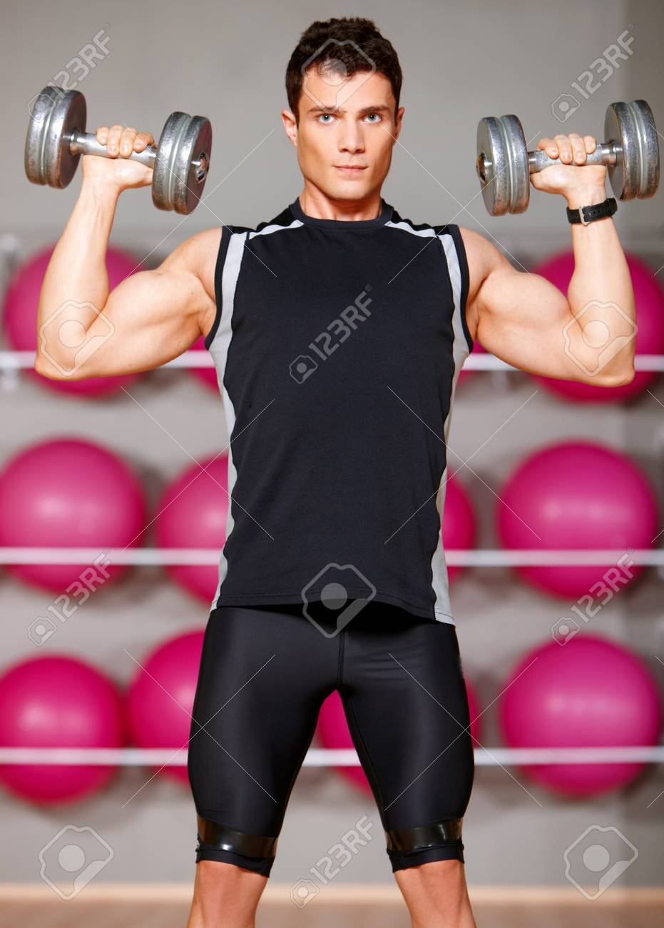 Handsome man at the gym doing exercises Stock Photo - 9795985