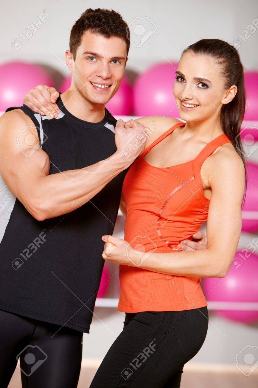 Sporty couple exercising at the fitness gym Stock Photo - 9796045