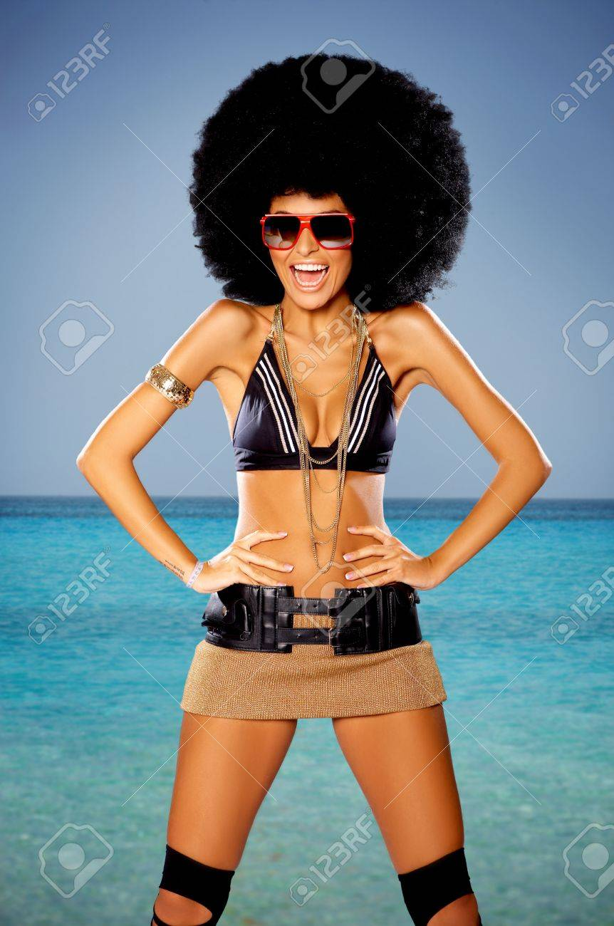 Woman with huge afro haircut close to water Stock Photo - 9796542