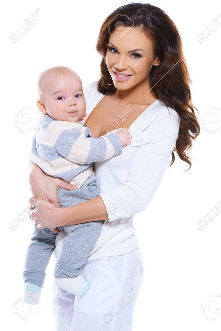 Smiling attractive young mother clasping her cute chubby her young baby in  her arms isolated on