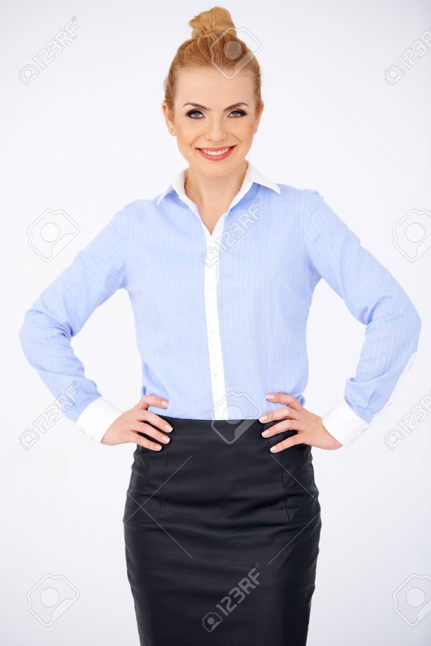 Blond girl standing and holding her hands on her hips. White background Stock Photo - 17968808