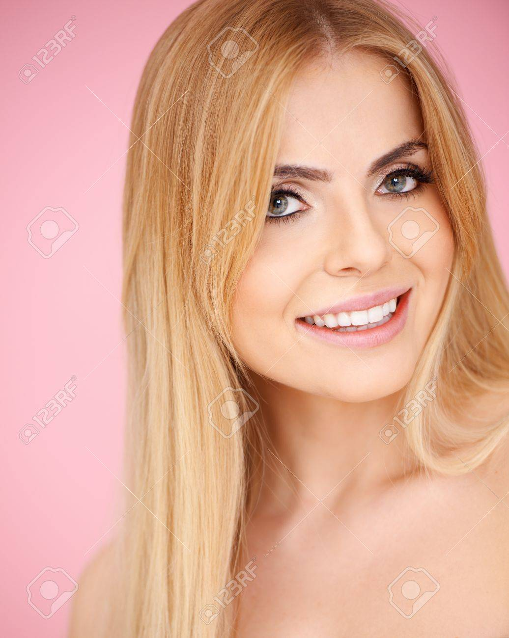 Beautiful smiling blond girl on pink background Stock Photo - 17968840