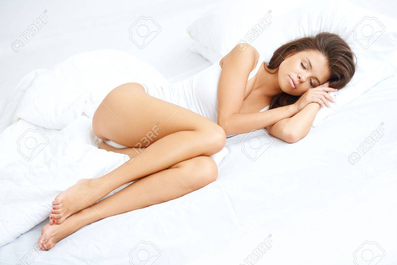 Sexy girl sleeping in bed