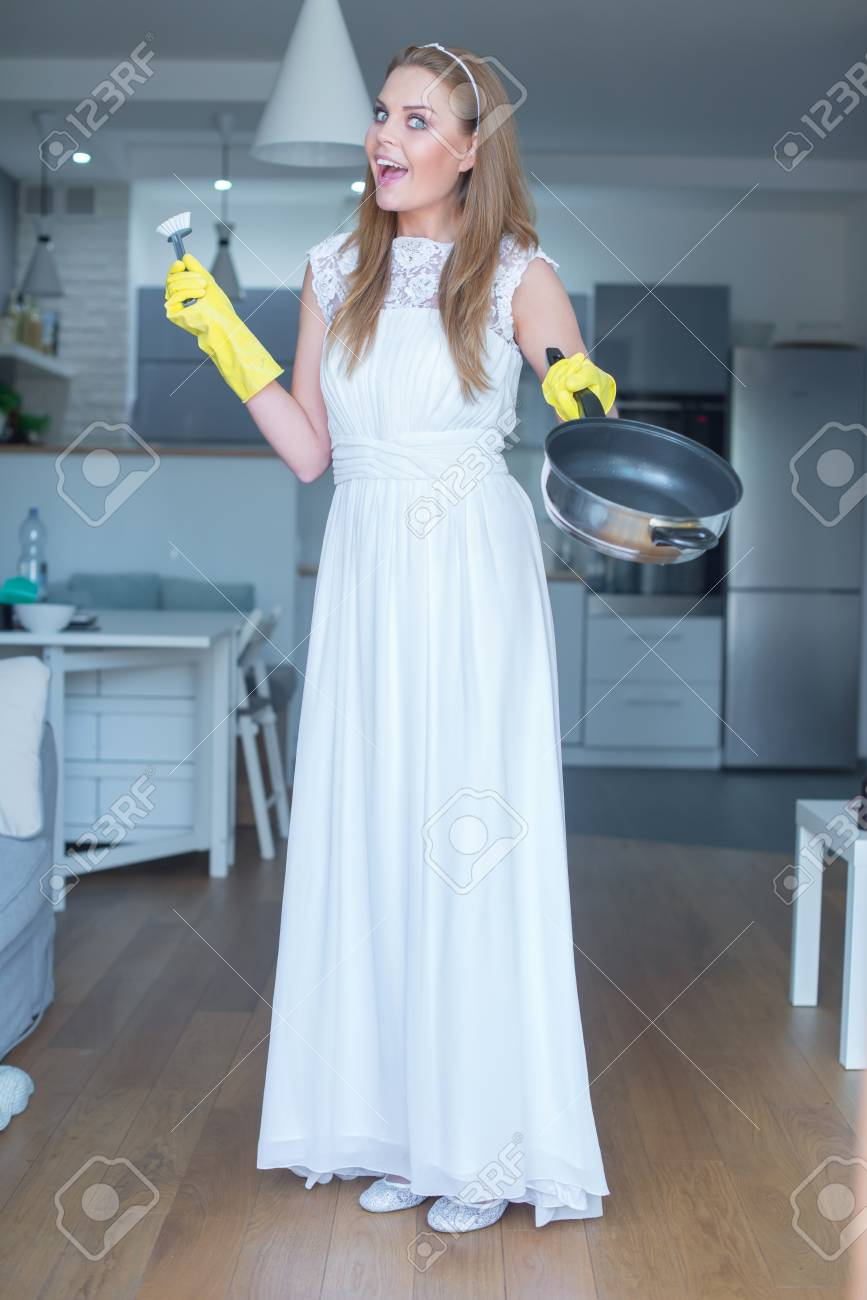 Woman Wearing White Wedding Gown Showing Clean Pan And Standing ...