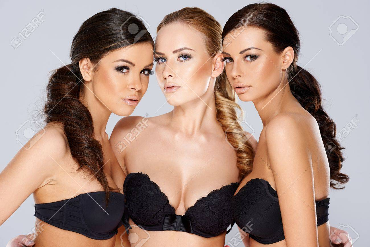 00b37dd2ec762 Close up Three Gorgeous Young Women in Sexy Black Strapless Bras Looking at  the Camera Sensually