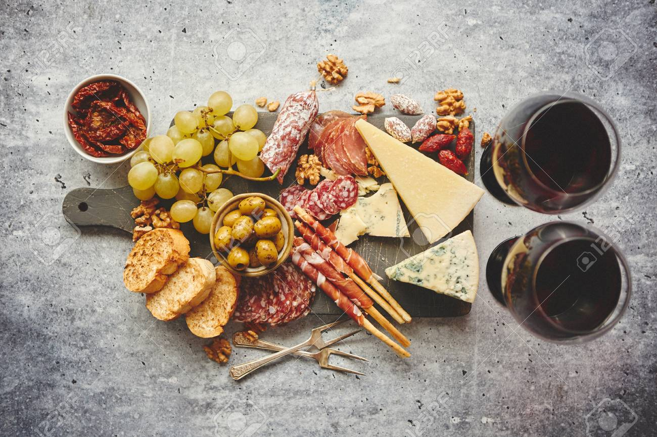 Antipasto Platter Cold Meat And Cheese Board With Grapes Wine Stock Photo Picture And Royalty Free Image Image 111260224
