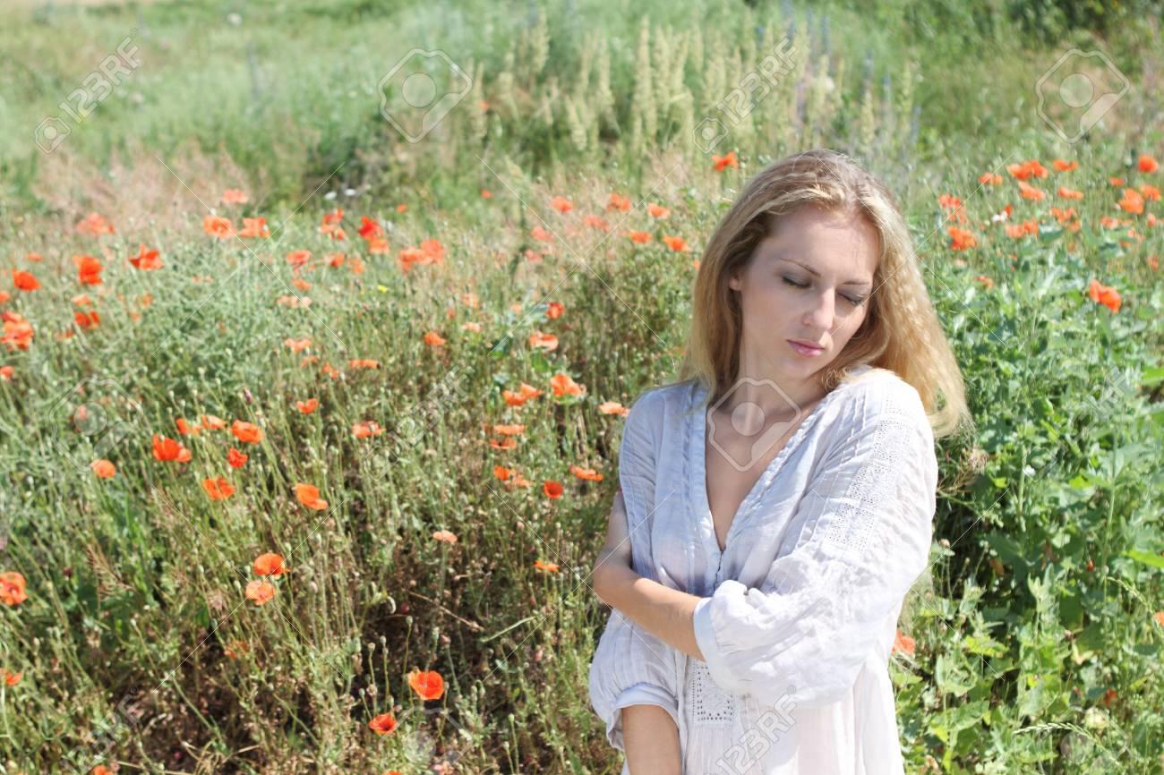 Beautiful blond girl in the poppy field Stock Photo - 7290549