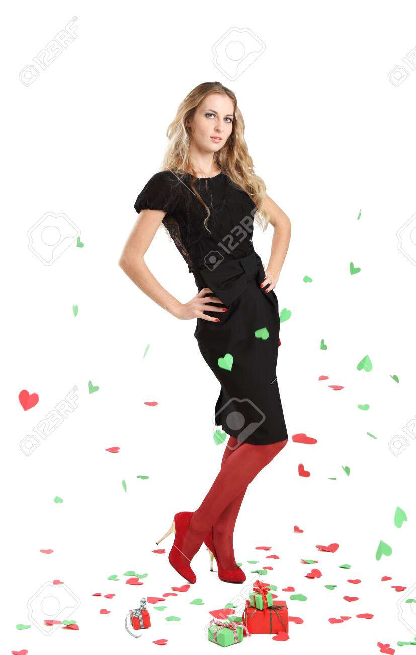 Attractive young woman in evening dress on background with red and green hearts Stock Photo - 8394225