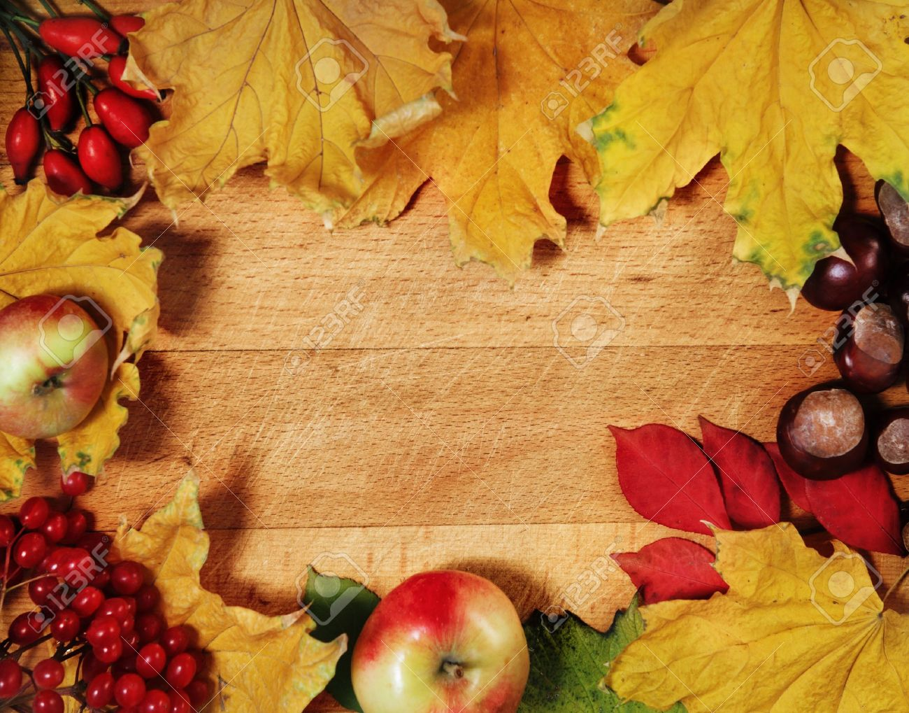 Still life with autumn leaves over wooden background Stock Photo - 10114883