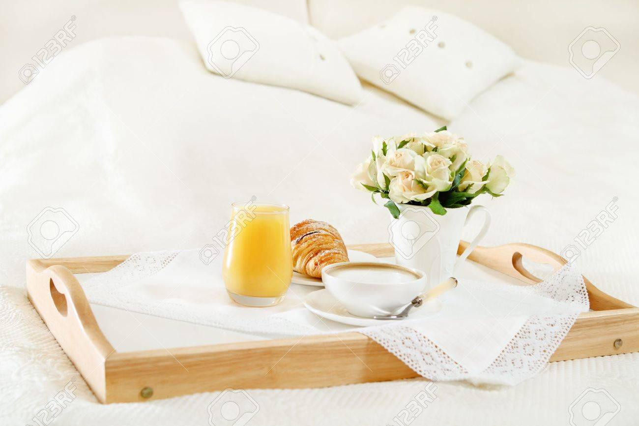 Breakfast in bed with coffee, orange juice and croissant on a tray Stock Photo - 10451601