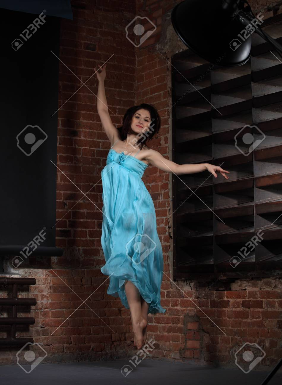 Young brunette woman dancing over brick walls Stock Photo - 12285182