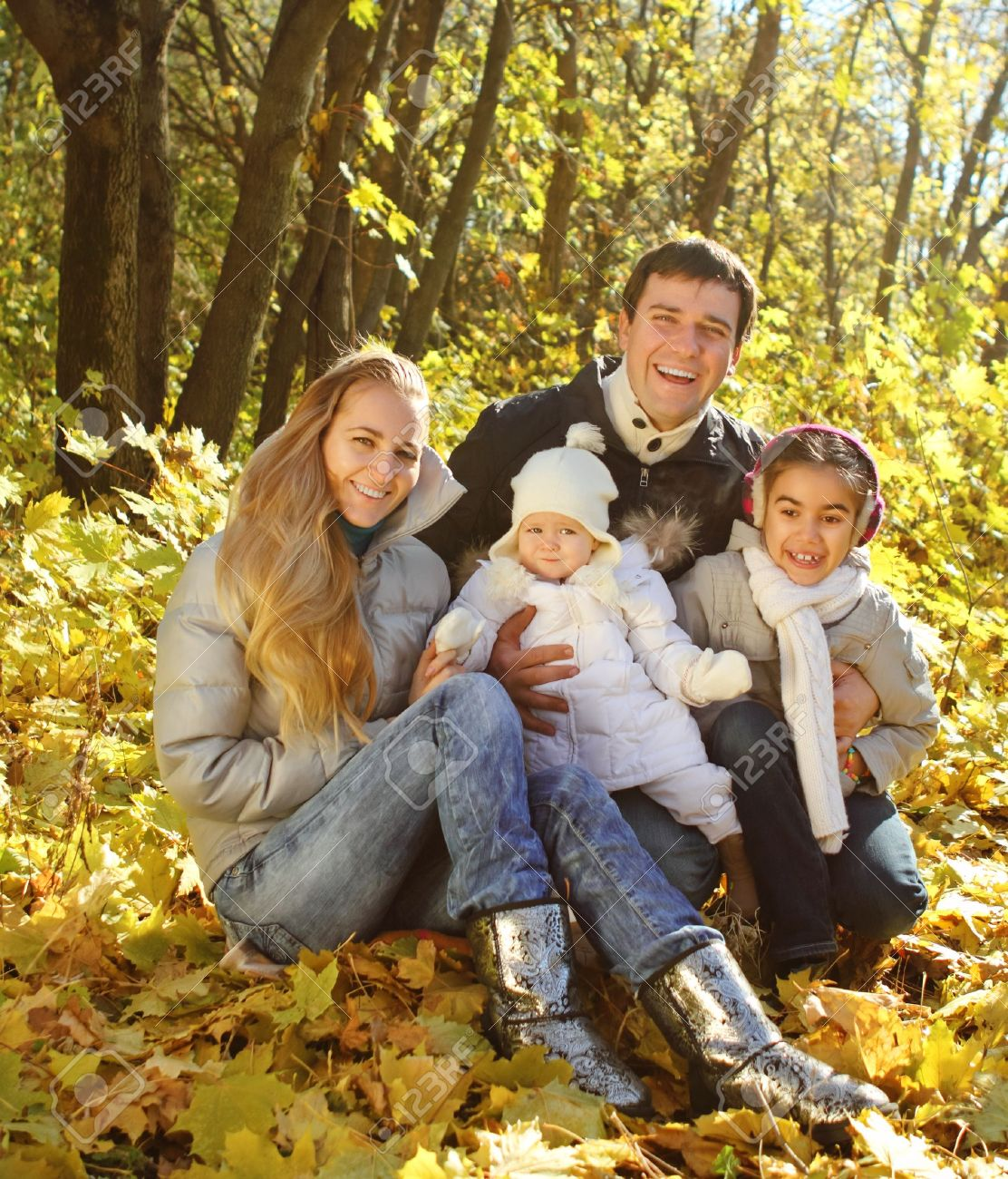 Young happy family with two daughters in autumn forest Stock Photo - 14383858