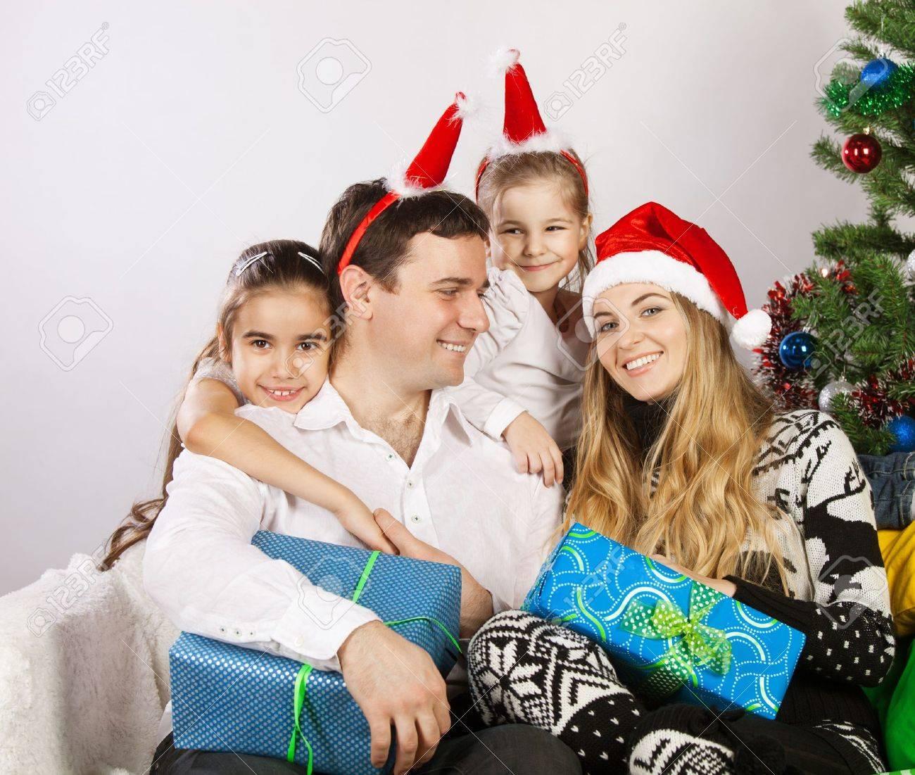 Happy family with Christmas presents near the Christmas tree Stock Photo - 15265328