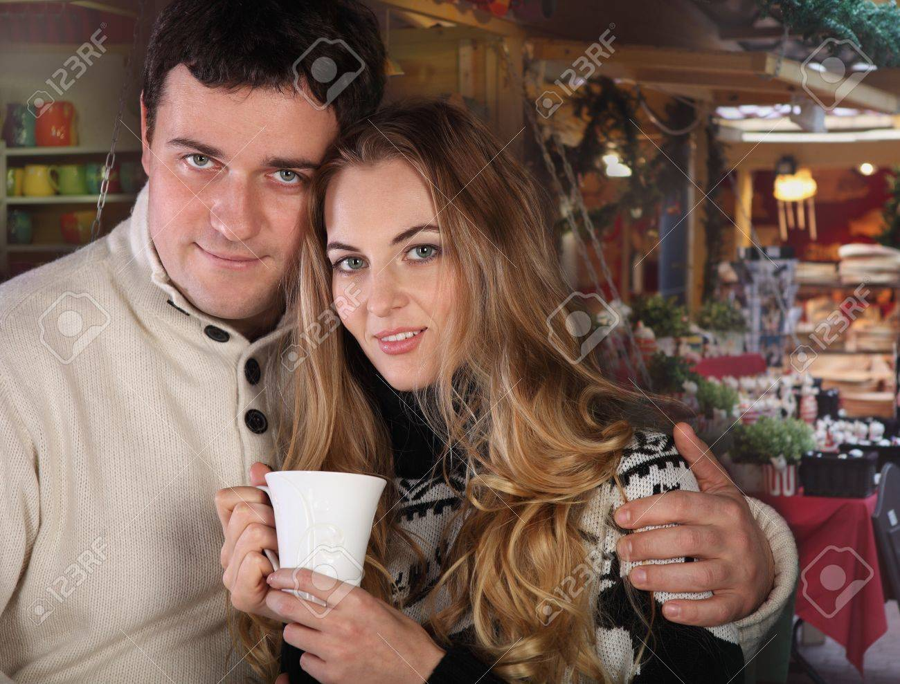 Portrait of a happy young couple on Christmas market Stock Photo - 15574607