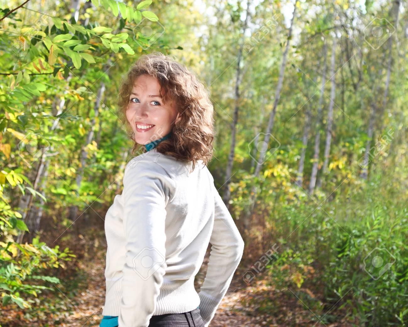 Beautiful young woman outdoors Stock Photo - 16606165