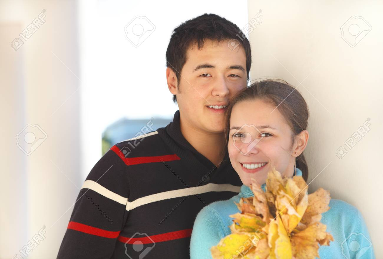 Happy young couple in love outdoors Stock Photo - 16789431