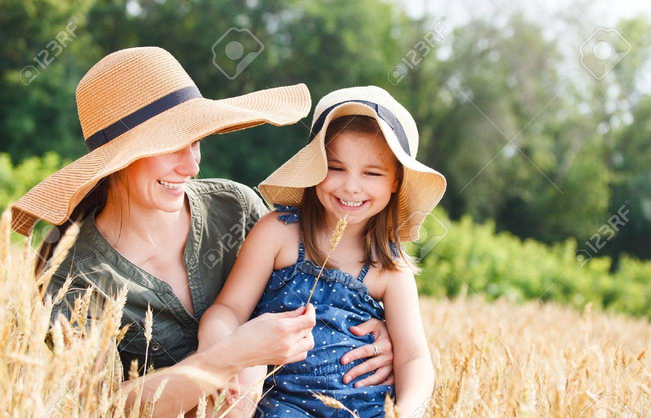 Happy mother and her little daughter in the wheat field Stock Photo - 17416452