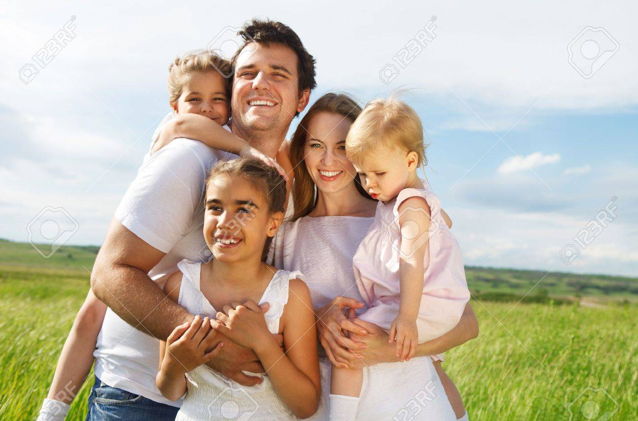 4ecfe89d3b0 Happy young family with three children outdoors Stock Photo - 17566251