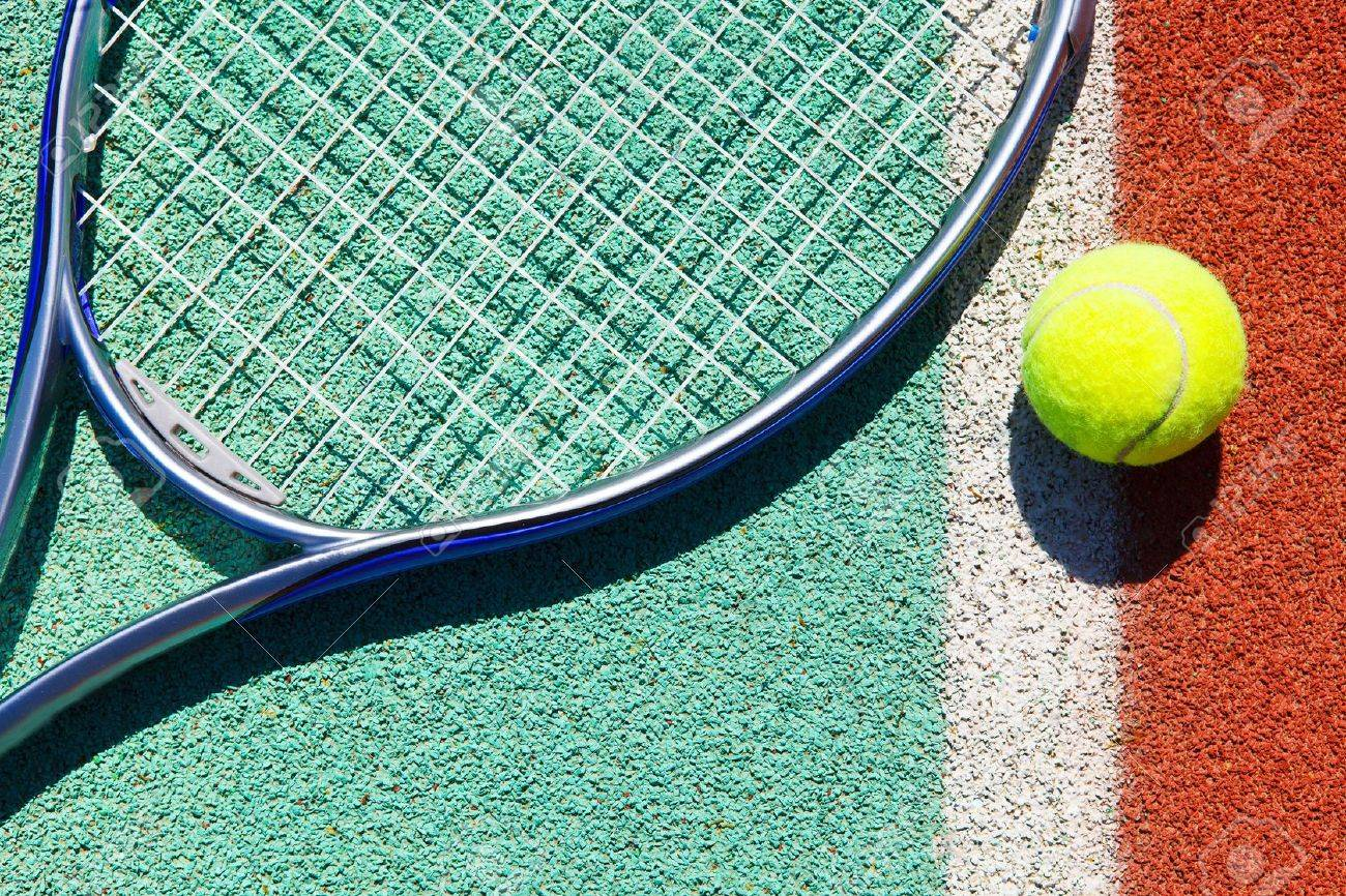 Close up of tennis racquet and ball on the clay tennis court Stock Photo - 20523685