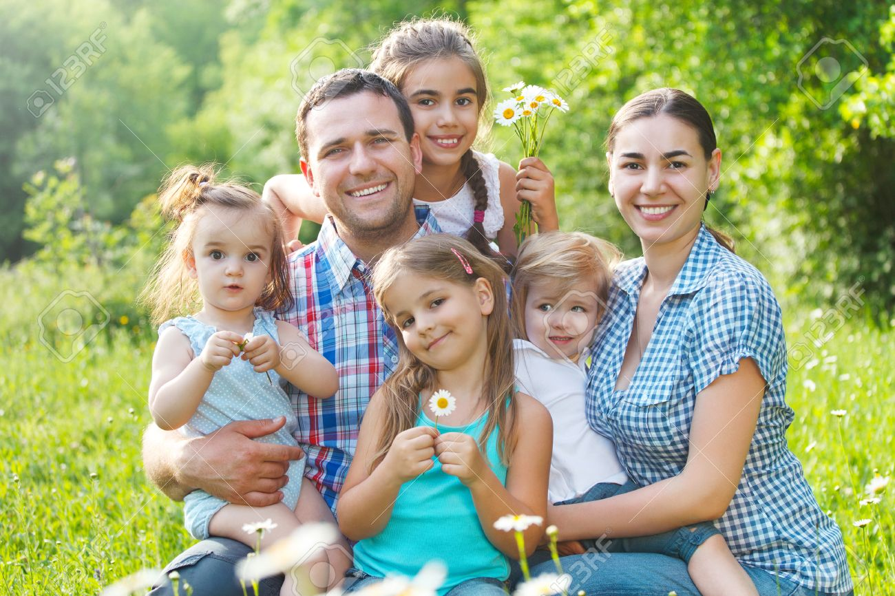 d52955bbd3a Happy young family with four children in the spring forest Stock Photo -  26527420