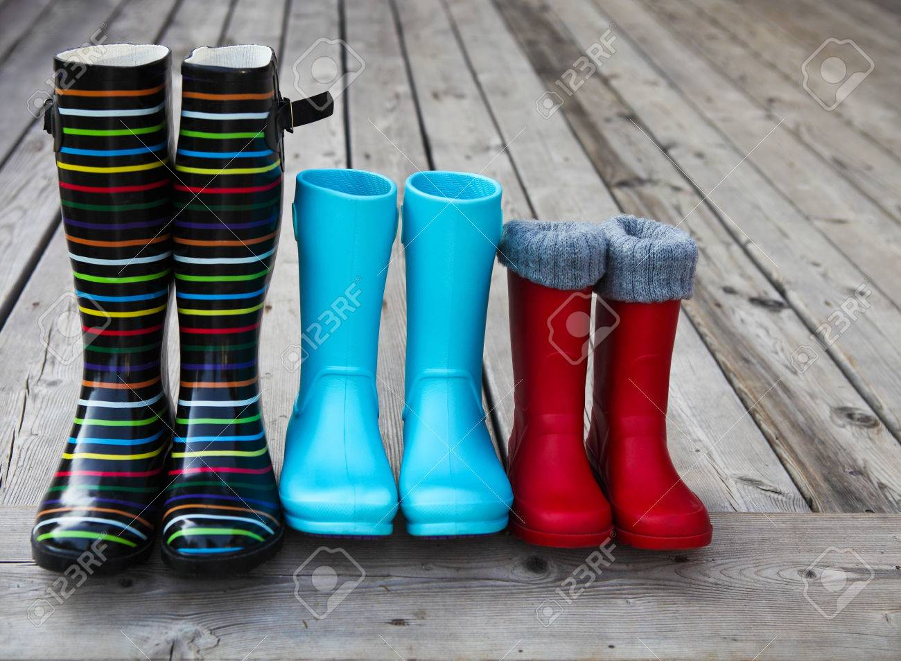 Three Pairs Of A Colorful Rain Boots. Family Concept Stock Photo ...