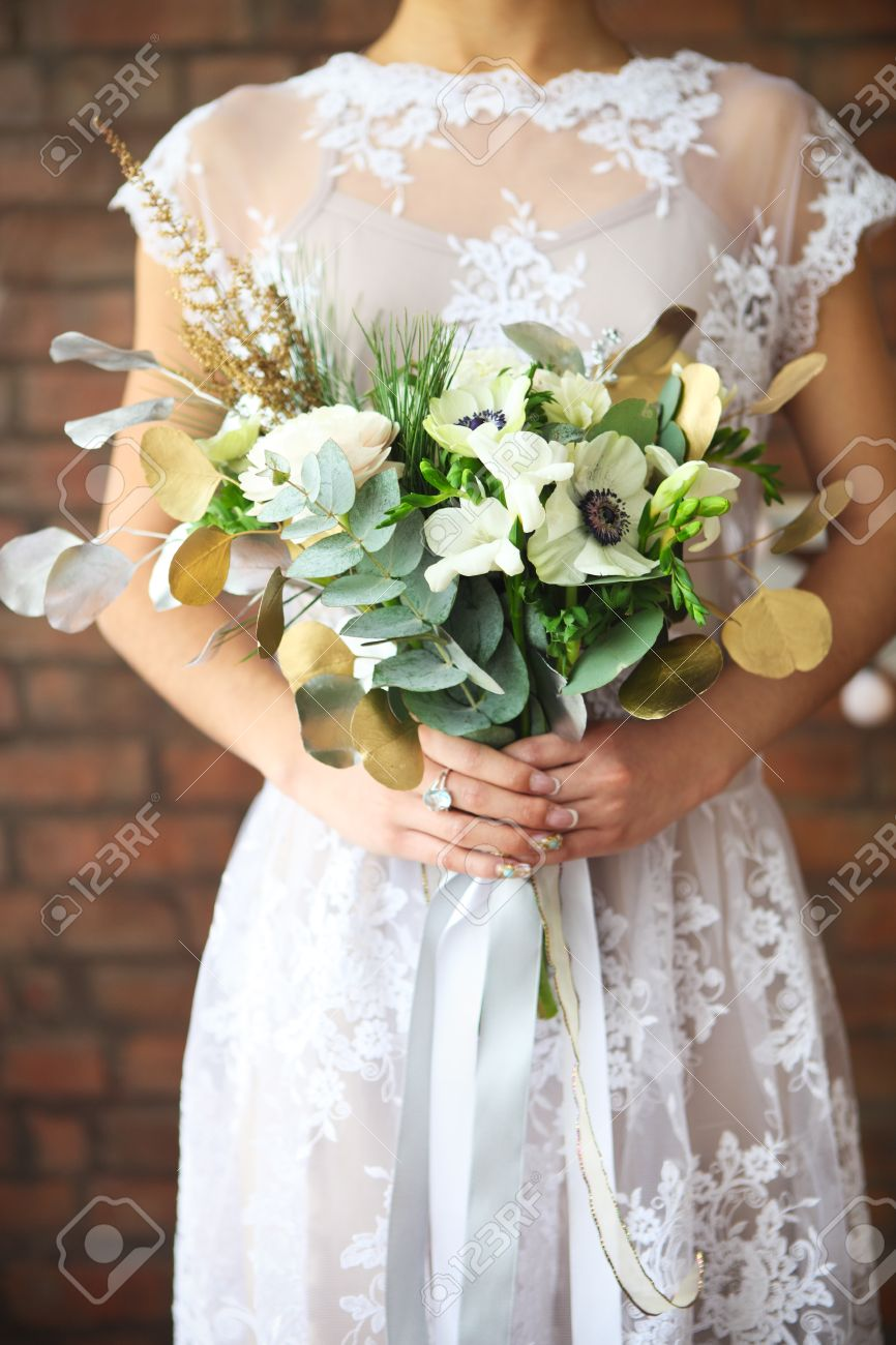Unusual wedding bouquet with ranunculus freesia roses and white stock photo unusual wedding bouquet with ranunculus freesia roses and white anemone in retro style at hands of a bride izmirmasajfo