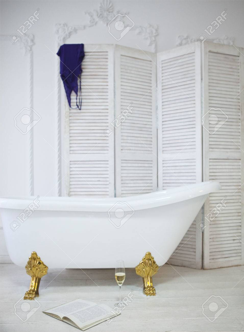 Claw Foot Bath In A White Classical Bathroom With Champagne And ...