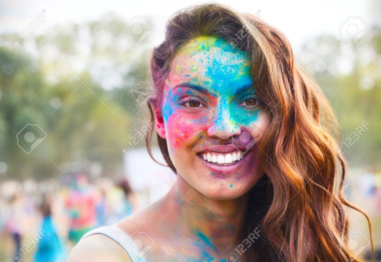 Portrait of happy young girl on holi color festival - 36309184