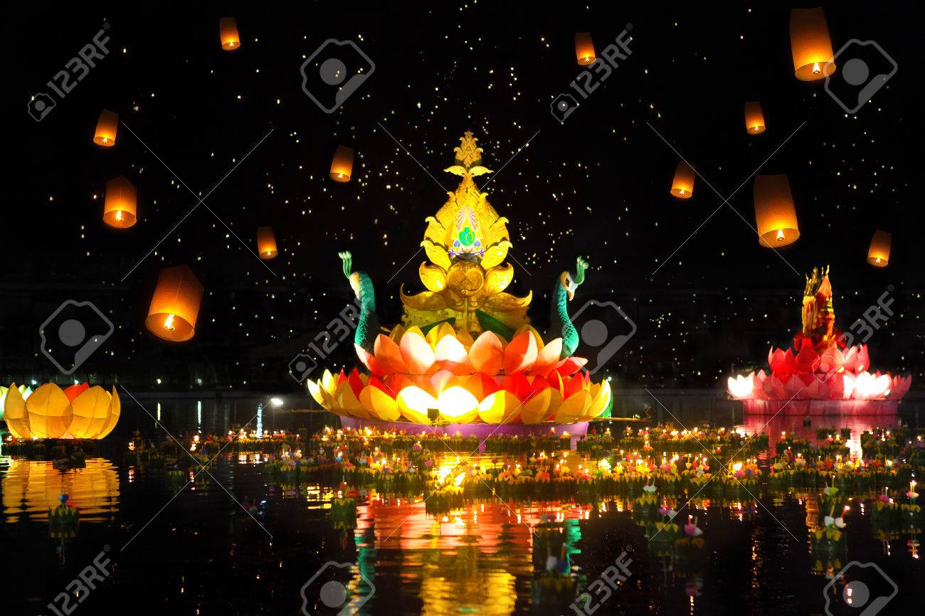 Big and small boats with candles and flowers are given for Thailands traditional Loy Krathong Festival. Sky lanterns in the sky - 36582368