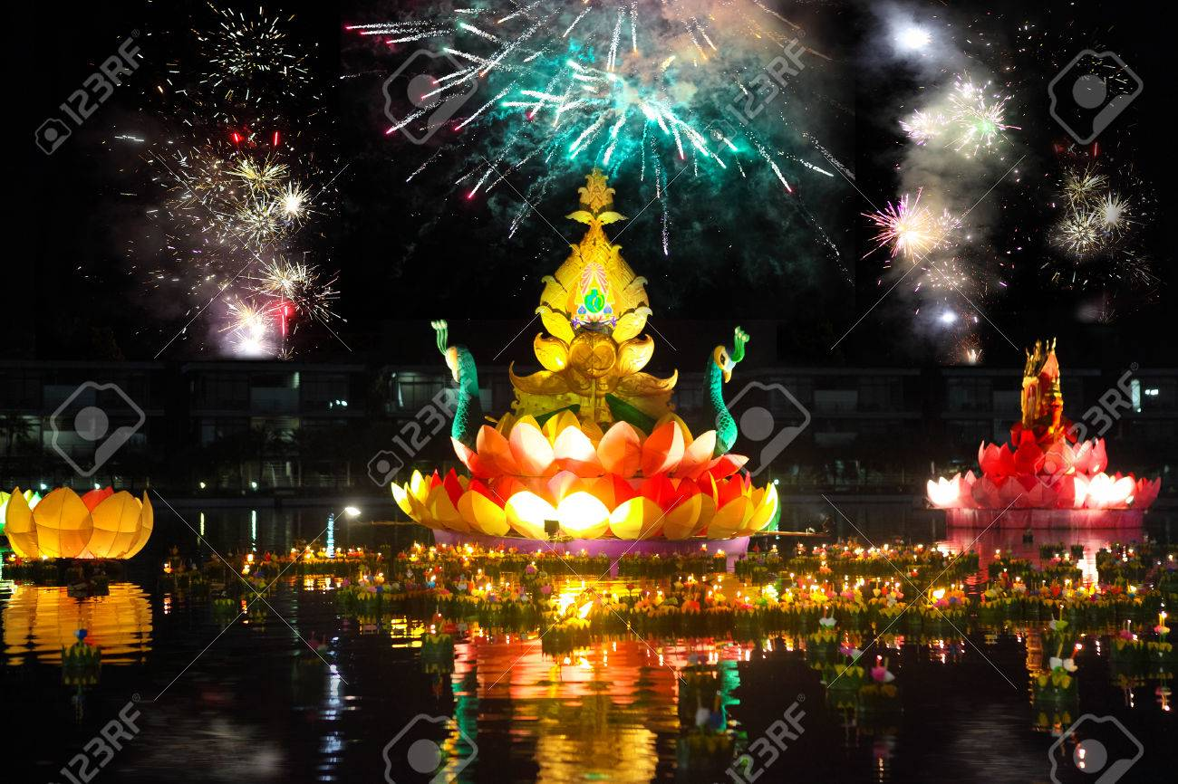 Big and small boats with candles and flowers are given for Thailands traditional Loy Krathong Festival. Fireworks in the sky - 36867503