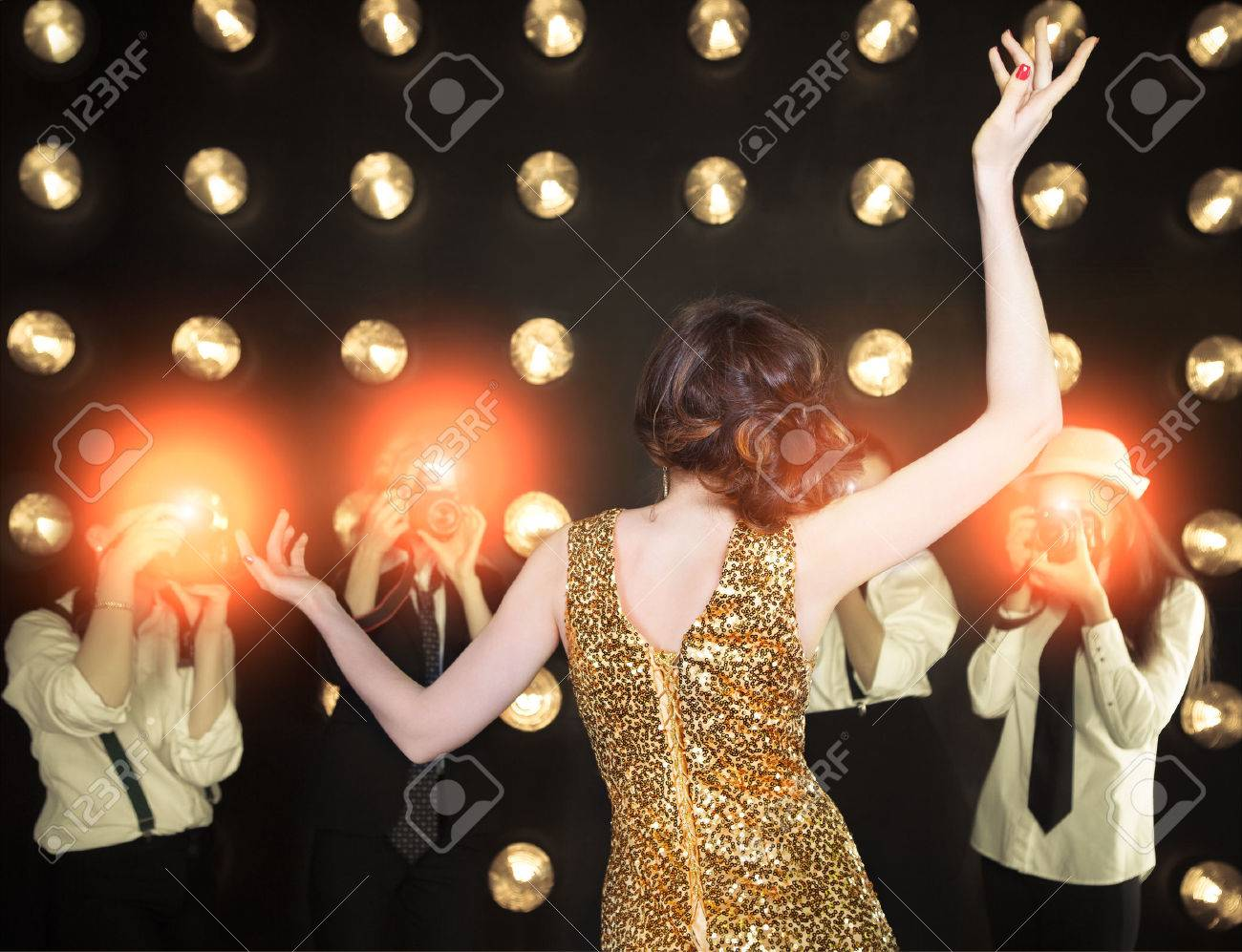 Superstar woman wearing golden shining dress posing to paparazzi - 38253521