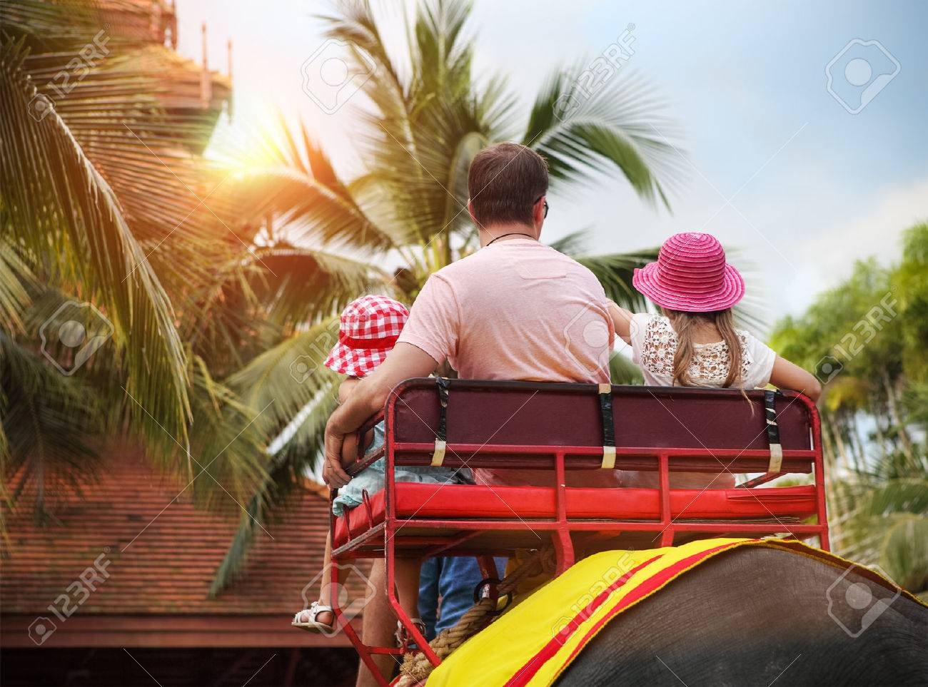 Man and his daughters riding on the back of elephant in Thailand - 39033622