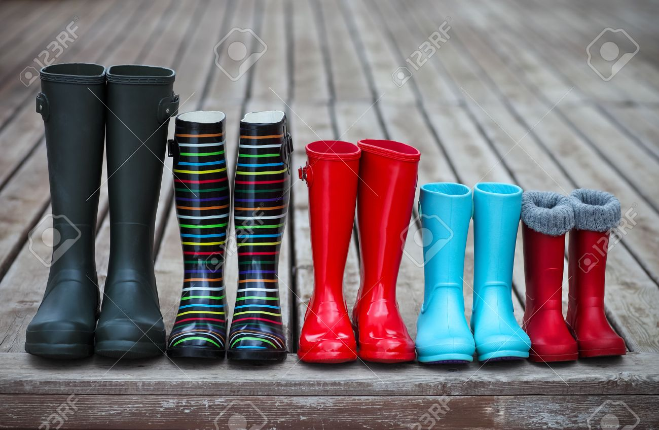 Five Pairs Of A Colorful Rain Boots. Family Concept Stock Photo ...